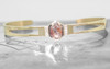 MERU 14k yellow gold cuff bracelet with cut out details. Hexagon gray and rust diamond prong set in center flanked by three brilliant white pave diamonds. New Classic collection. Shown on metal background with Chinchar/Maloney logo