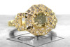 Vesuvio ring in 14k yellow gold.  1.63 carat champagne center diamond, cushion brilliant cut.  Halo and buckle band are covered in organic brilliant champagne, gray, white pave.  3/4 view on a metal plate with Chinchar/Maloney logo.