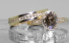 2.17 carat oval, faceted cut deep Cocoa bezel/prong set diamond ring set in 14k yellow gold with six 1.2mm brilliant champagne diamonds set in flat band. With Eternity Wedding Band with brilliant champagne diamonds set in 14k yellow gold 4mm wide and 1.5mm thick flat band