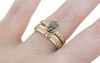 2.17 carat oval, faceted cut deep Cocoa bezel/prong set diamond ring set in 14k yellow gold with six 1.2mm brilliant champagne diamonds set in flat band. With Eternity Wedding Band with brilliant champagne diamonds set in 14k yellow gold 4mm wide and 1.5mm thick flat band on a hand