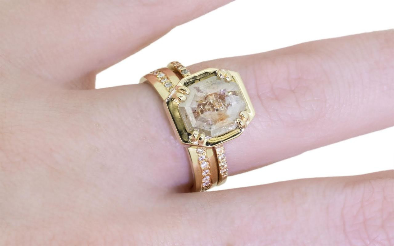 AIRA 1.49 carat cognac champagne hexagon cut prong set in 14k yellow gold geometric octangular setting. 1.2mm brilliant champagne pave diamonds set in 14k  yellow gold band. New Classic Collection. Modeled on hand with Show with 14k gold eternity pave diamond wedding band.