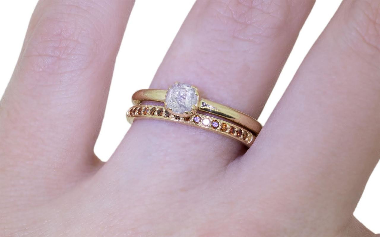 .50 carat  cushion, rose cut icy white bezel set diamond ring set in 14k yellow gold 1/2 round band. With Wedding Band with 16 brilliant cognac diamonds set in 14k yellow gold 1/2 round band on a hand