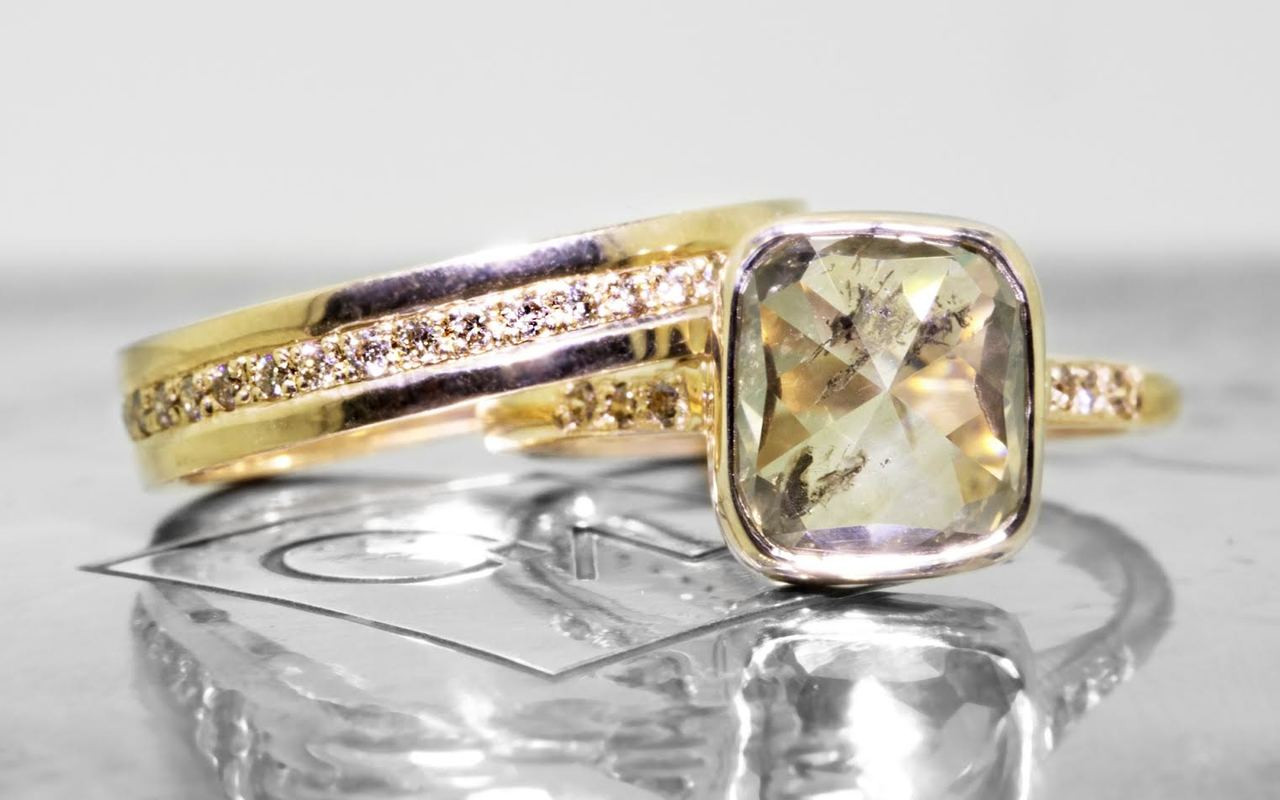 3.20 carat cushion, rose cut translucent rustic champagne bezel set diamond ring set in 14k yellow gold with six 1.2mm brilliant champagne diamonds set in 1/2 round band. With Eternity Wedding Band with 1.2mm brilliant champagne diamonds set in 14k yellow gold 4mm wide and 1.5mm thick flat band