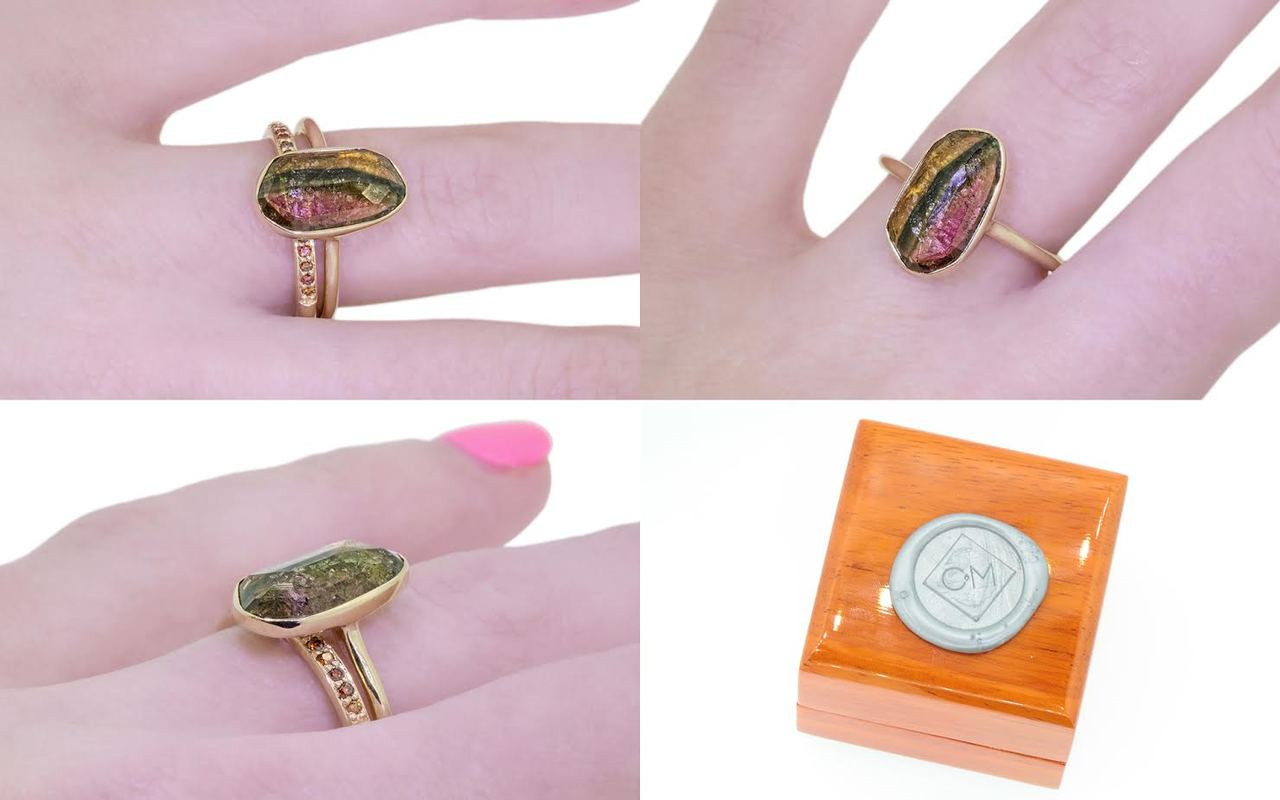 2.89 carat watermelon tourmaline set in 14k yellow gold 1/2 round band. with Wedding Band with 16 rubies in 14k yellow gold on a hand with wooden box stamped with wax seal Chinchar/Maloney logo