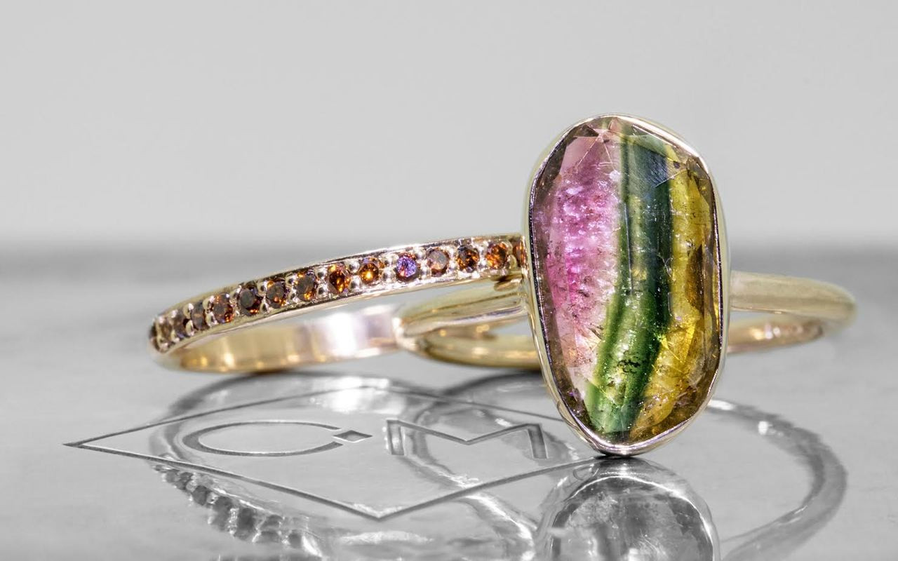2.89 carat watermelon tourmaline set in 14k yellow gold 1/2 round band. with Wedding Band with 16 rubies in 14k yellow gold.