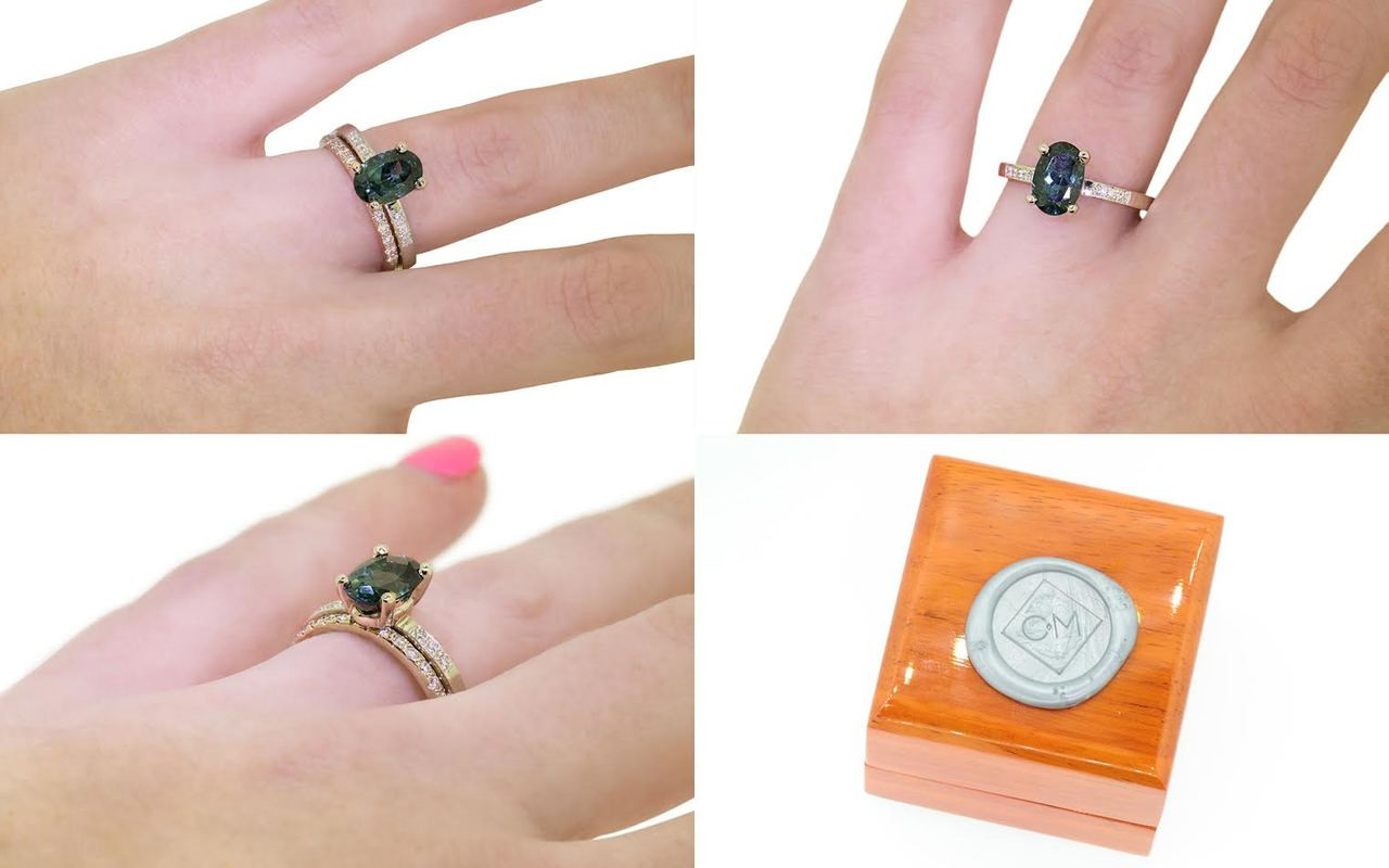 1.70 carat oval, faceted cut deep blue/green tourmaline with six 1.2mm brilliant white diamonds set in 14k white gold flat band. With Wedding Band with 16 brilliant white diamonds set in 14k white gold on a hand with wooden box stamped with wax seal Chinchar/Maloney logo