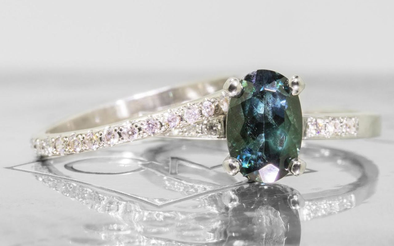 1.70 carat oval, faceted cut deep blue/green tourmaline with six 1.2mm brilliant white diamonds set in 14k white gold flat band. With Wedding Band with 16 brilliant white diamonds set in 14k white gold