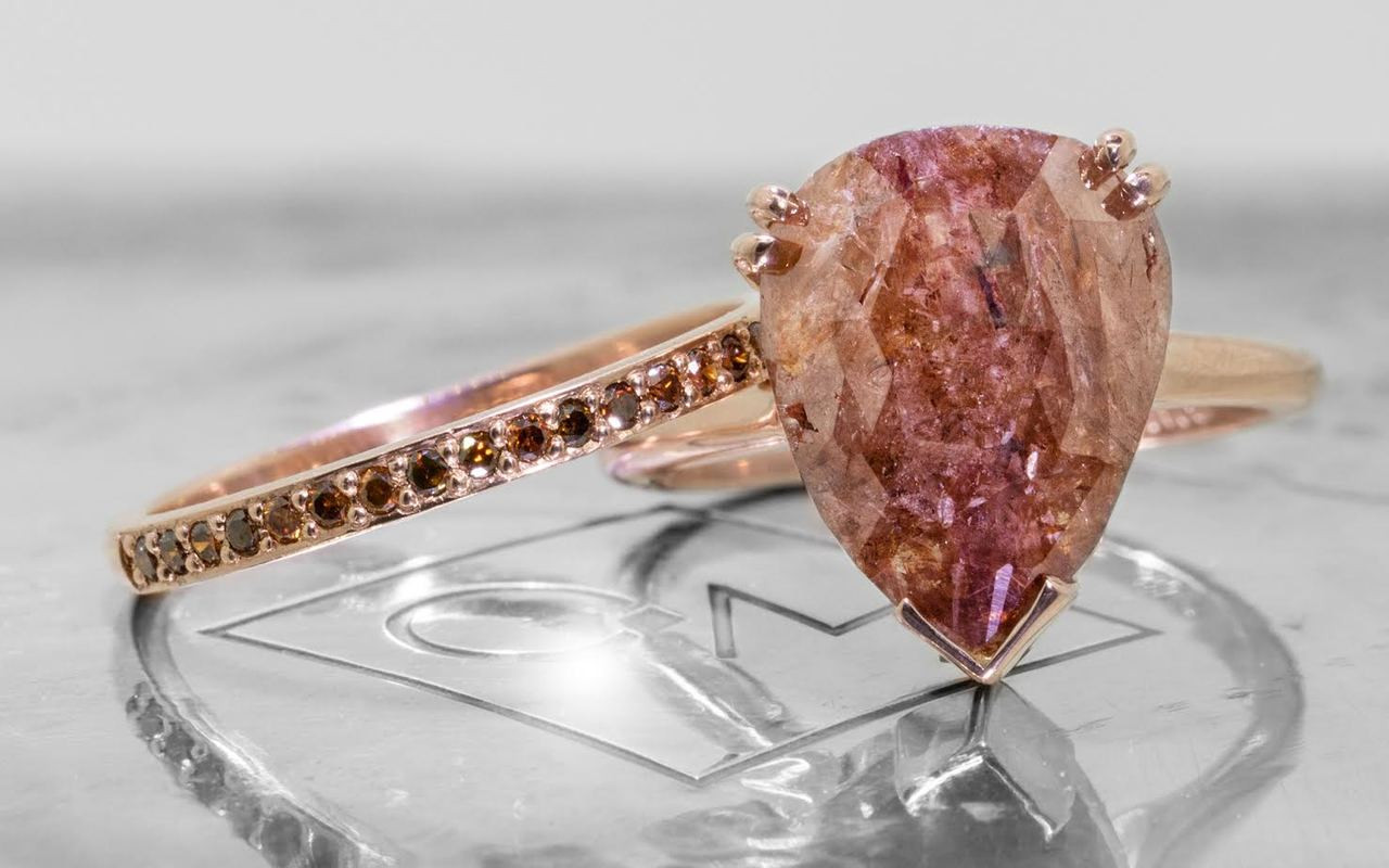 7.21 carat pear, rose cut natural rich cognac prong set diamond ring set in 14k rose gold 1/2 round band. With Wedding Band with sixteen 1.2mm brilliant champagne diamonds set in 14k rose gold 1/2 round band