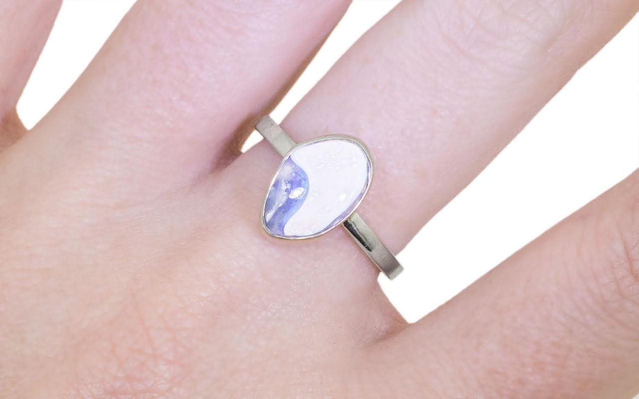 1.86 carat australian lightning ridge opal set in 14k white gold 2mm flat band on a hand