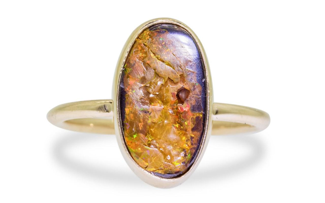 2.80 carat boulder opal in 14k yellow gold half round band front view on white background