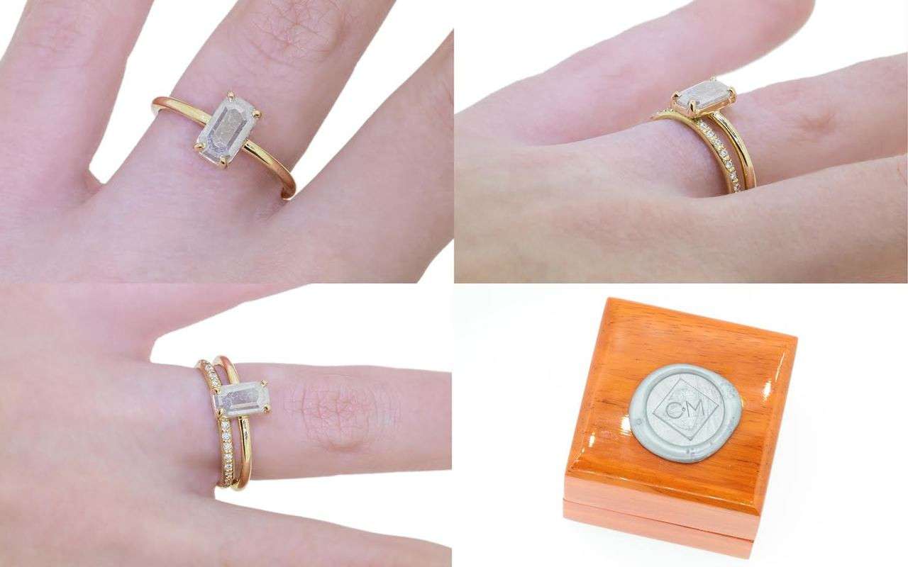 .58 carat fancy-cut gray prong set diamond ring set in 14k yellow gold 1/2 round band. With Wedding Band with 16 white brilliant diamonds set in 14k yellow gold 1/2 round band on a hand with wooden box stamped with wax seal Chinchar/Maloney logo