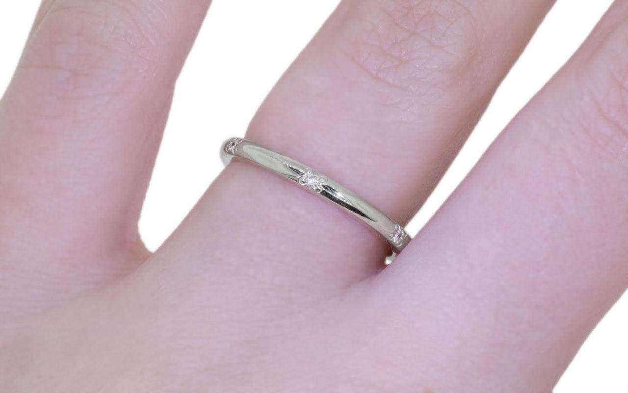 14k white gold wedding band with 6 brilliant white pave diamonds modeled on hand