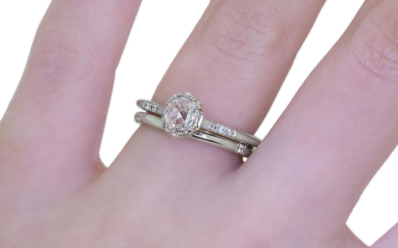 14k white gold wedding band with 6 brilliant white pave diamonds modeled on hand with diamond ring
