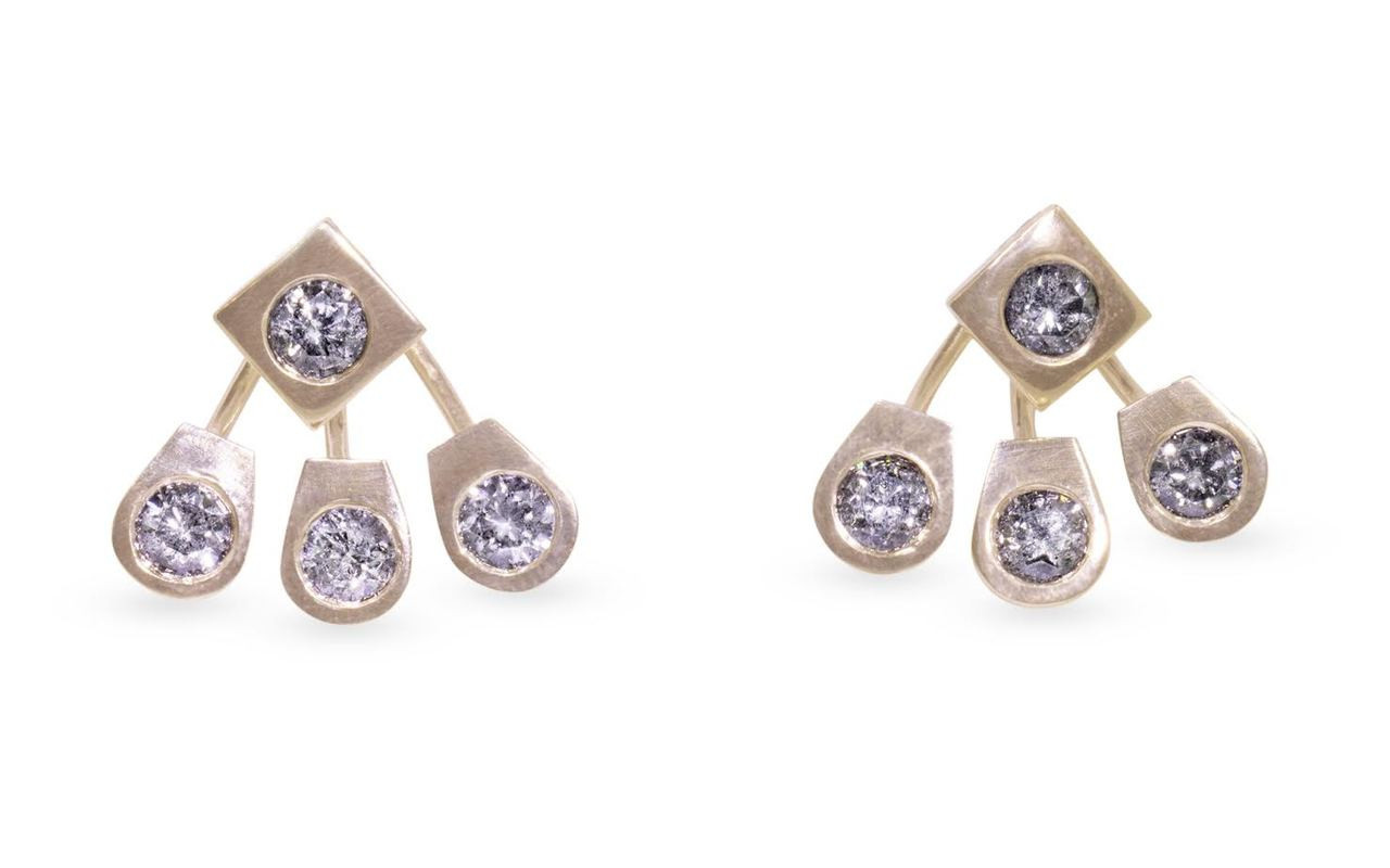 Brilliant, round gray diamonds set in 14k yellow gold front-back earrings.  The front stud is a square-diamond shape.  The back piece is three rounded gold pieces each containing a round gray diamond.  Front view on white background.