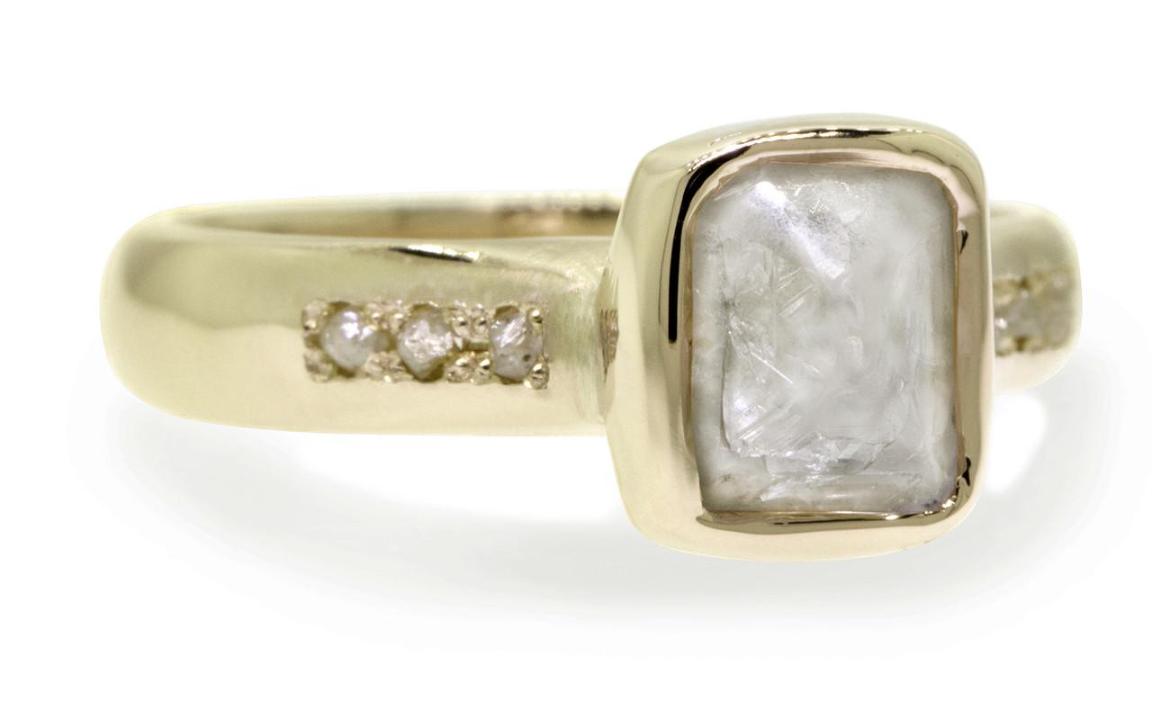 2.47 carat rough gray diamond six rough diamonds 14k yellow gold band 3/4 view on white background