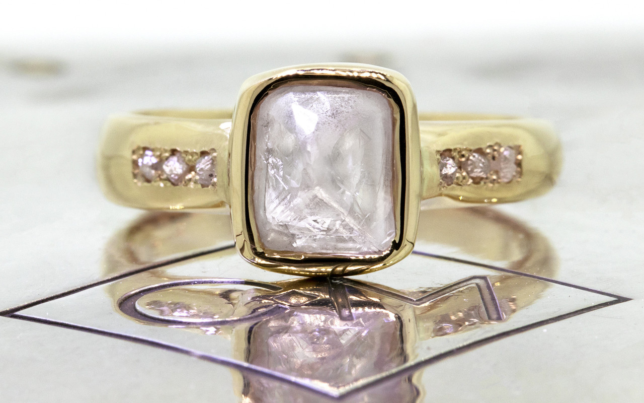 2.47 carat rough gray diamond six rough diamonds 14k yellow gold band front view on metal background with Chinchar/Maloney logo