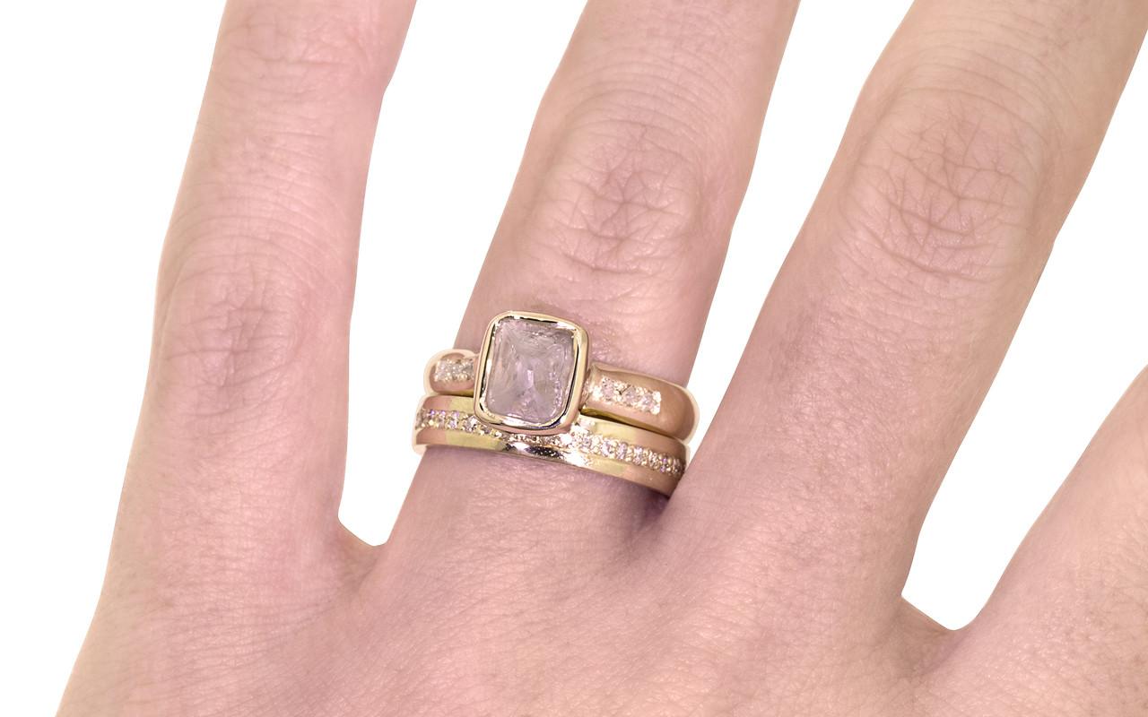 2.47 carat rough gray diamond six rough diamonds  14k yellow gold band with eternity Wedding Band with white Diamonds on a hand