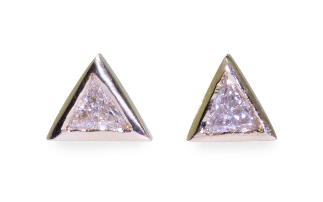 3mm trillion, white diamonds set in 14k yellow gold stud earrings.  Front view on white background.