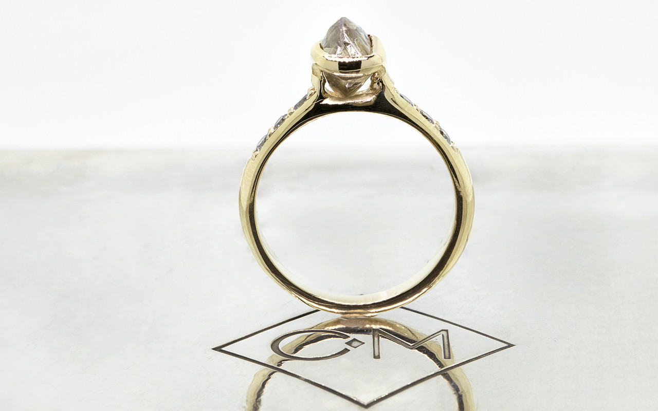 1.79 carat rough cocoa diamond six 2mm brilliant gray diamonds 14k yellow gold band standing up view on metal background with Chinchar/Maloney logo