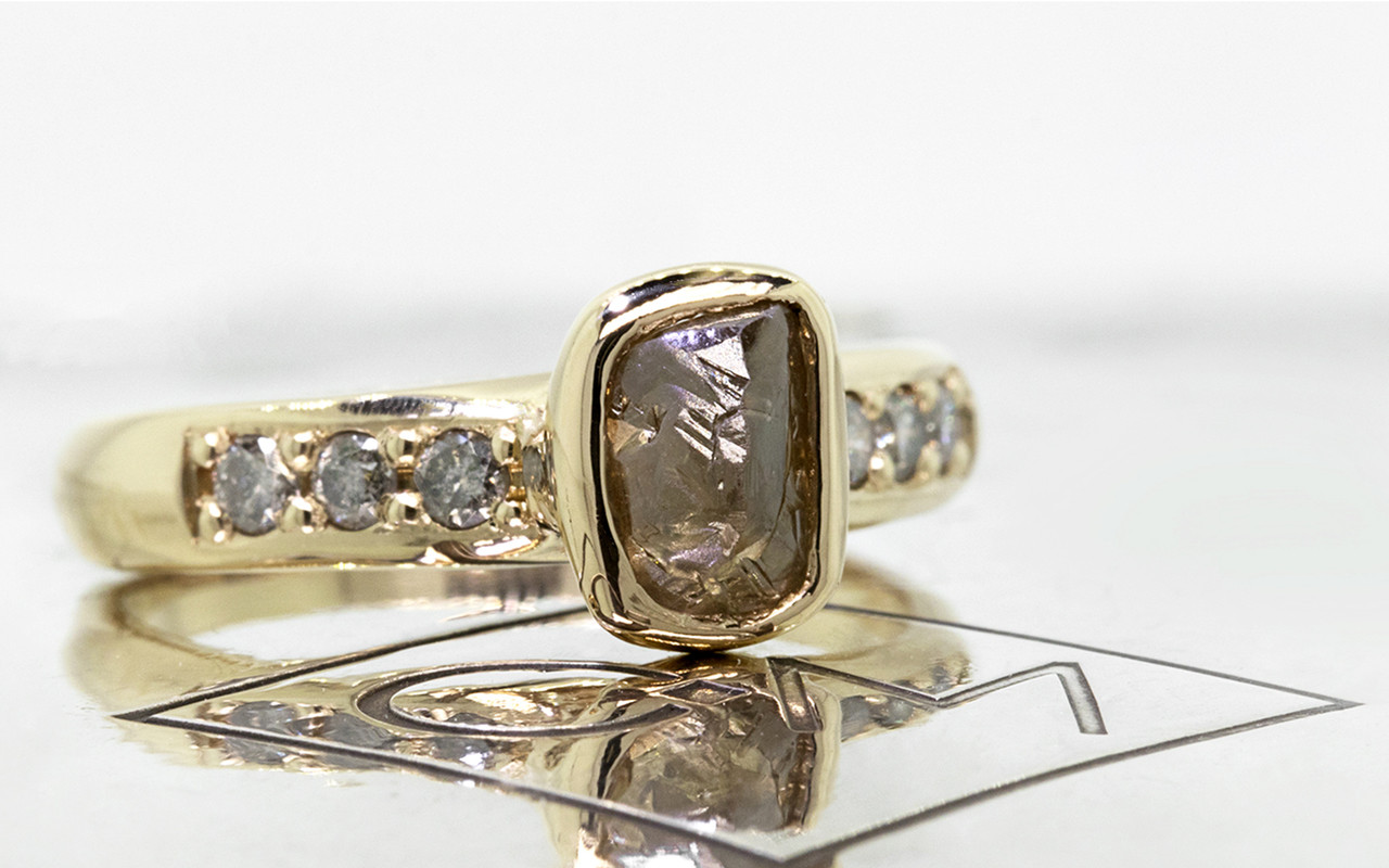 1.79 carat rough cocoa diamond six 2mm brilliant gray diamonds 14k yellow gold band 3/4 view on metal background with Chinchar/Maloney logo
