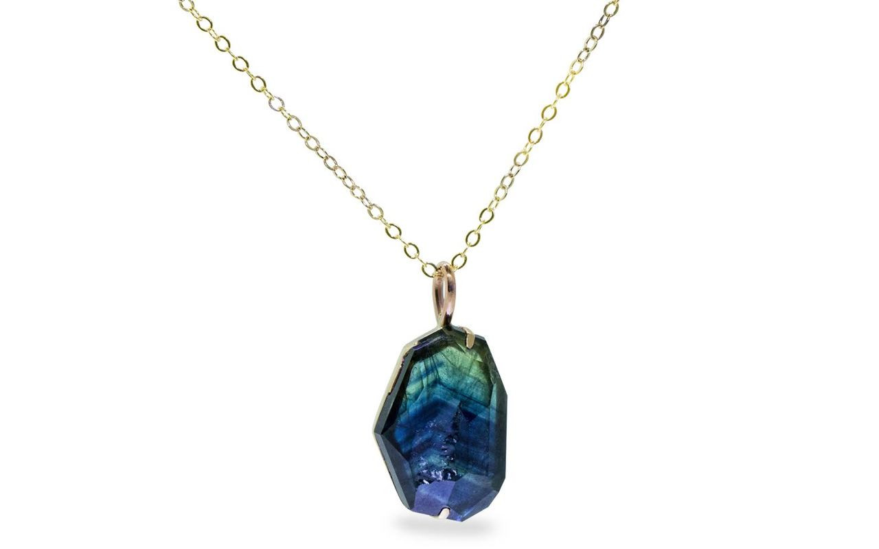 6.45 hand-cut blue green sapphire necklace set in 14k white gold with 14k white gold chain front view on white background