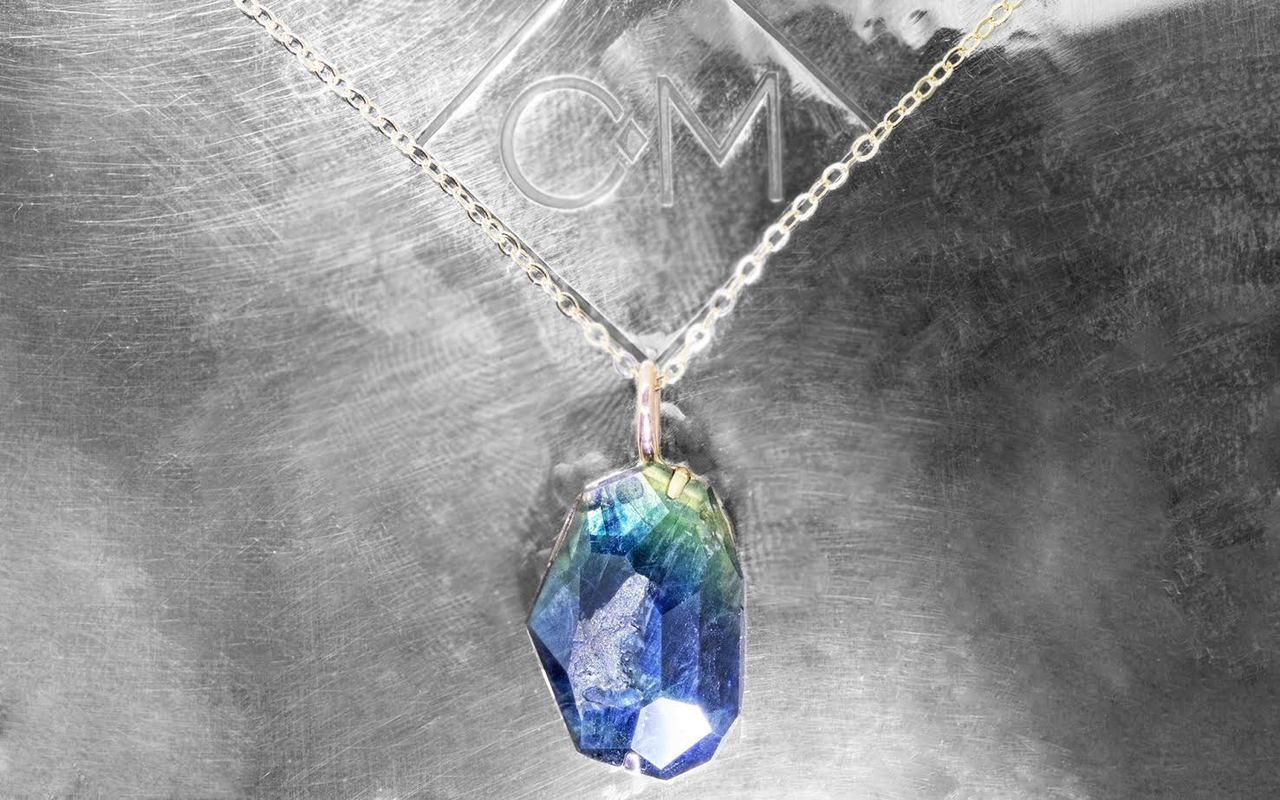 6.45 hand-cut blue green sapphire necklace set in 14k white gold with 14k white gold chain front view on metal background with Chinchar/Maloney logo
