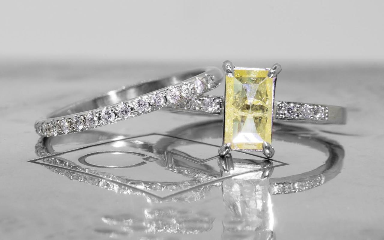 .92 carat fancy-cut sunny and vibrant yellow prong set diamond ring with six 1.2mm brilliant white diamonds set in 14k white gold flat band. With Wedding Band with 16 brilliant white diamond set in 14k white gold 1/2 round band
