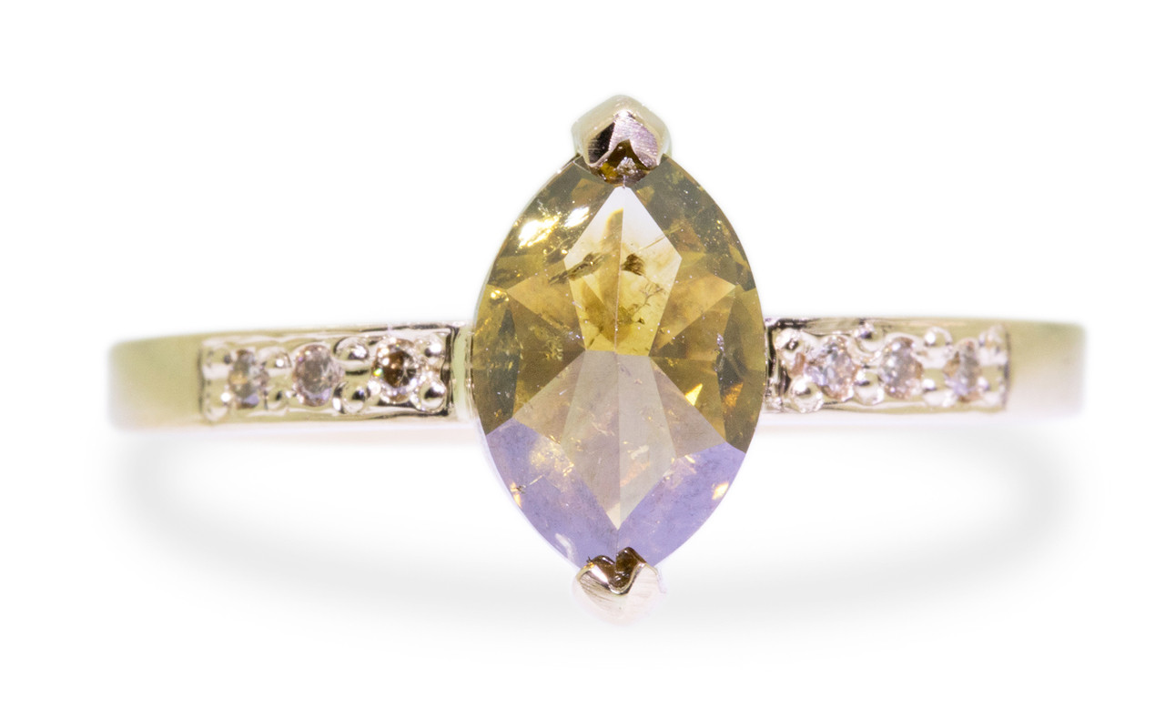 1.40 carat marquise, faceted-cut amber cognac prong set diamond ring set in 14k yellow gold with six 1.2mm brilliant champagne diamonds set in flat band. Front view on white background