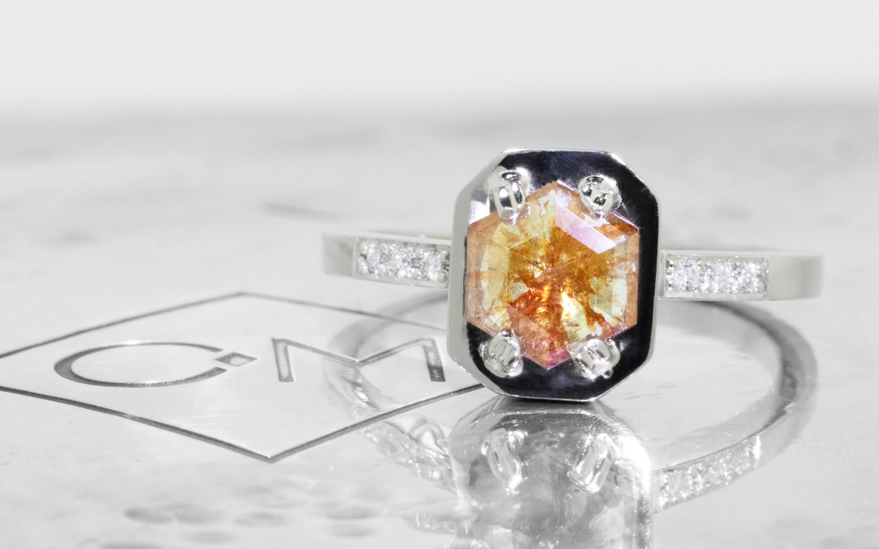 AIRA .77 carat hexagon rose cut peach champagne diamond prong set in 14k white gold geometric octangular setting. 1.2mm brilliant white diamonds set in 14k white gold band. New Classic Collection. On metal background with Chinchar/Maloney logo