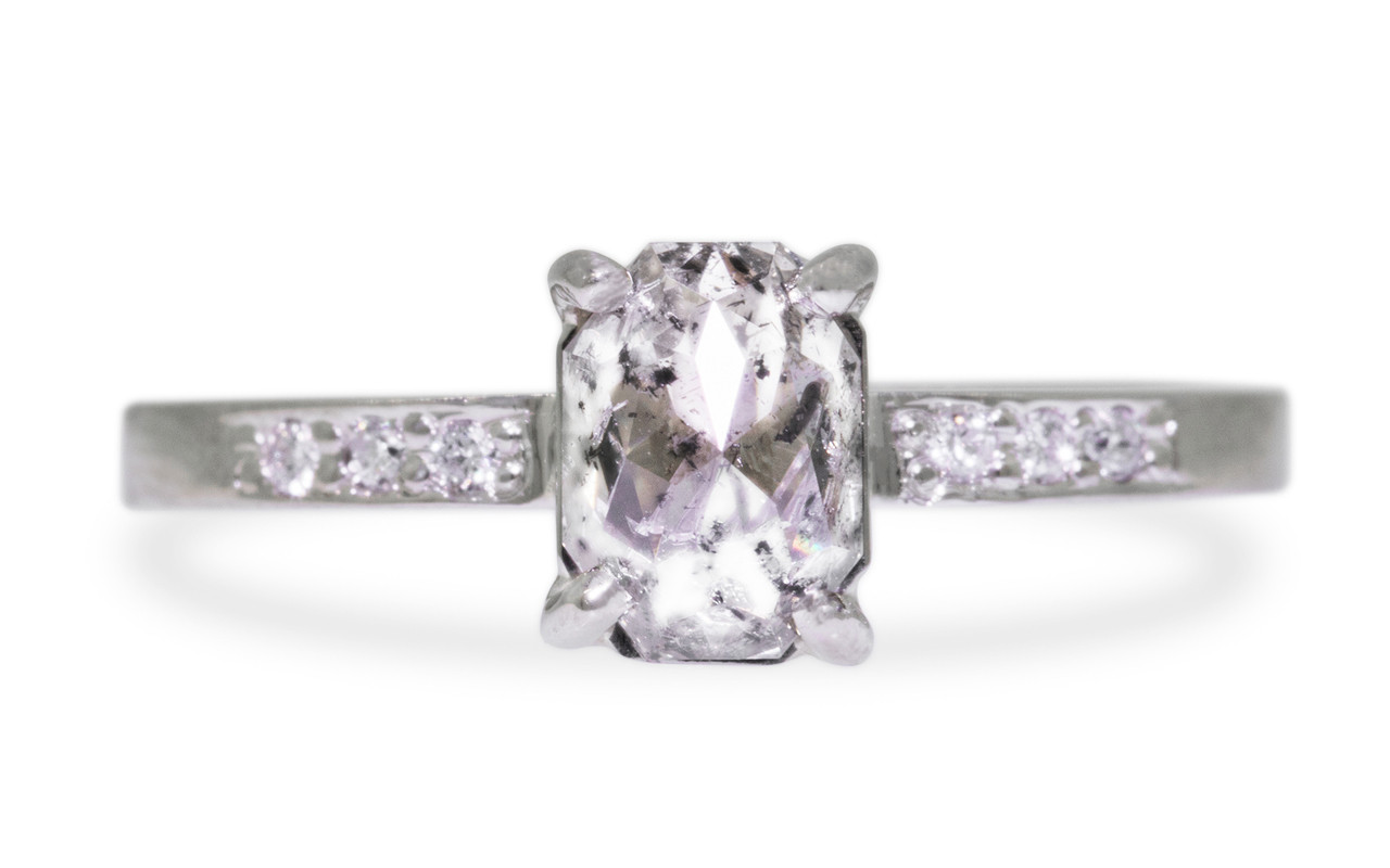 1.12 carat oval, rose cut translucent salt and pepper prong set diamond ring with six 1.2mm brilliant white diamonds set in band set in 14k white gold flat band. Front view on white background