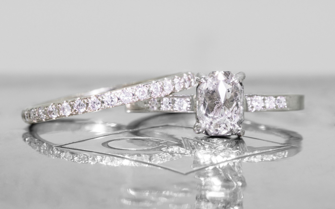 1.12 carat oval, rose cut translucent salt and pepper prong set diamond ring with six 1.2mm brilliant white diamonds set in band set in 14k white gold flat band. With Wedding Band with 16 brilliant white diamonds set in 14k white gold 1/2 round band
