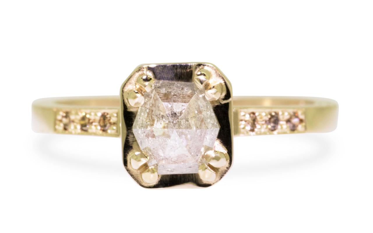 AIRA .76 carat hexagon rose cut light grayish diamond prong set in 14k yellow gold geometric octangular setting. Six 1.2mm brilliant champagne pave diamonds set in 14k yellow gold band. New Classic Collection.