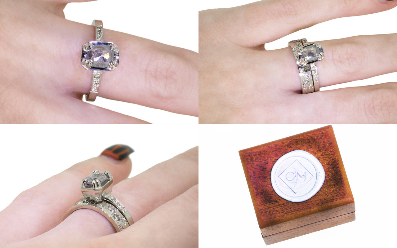 AIRA .73 carat oval rose cut smokey gray diamond prong set in 14k white gold geometric octangular setting. 1.2mm brilliant gray diamonds set in 14k white gold band. New Classic Collection. Modeled on hand with organic pave wedding band. Wooden ring box with silver Chinchar/Maloney wax seal.