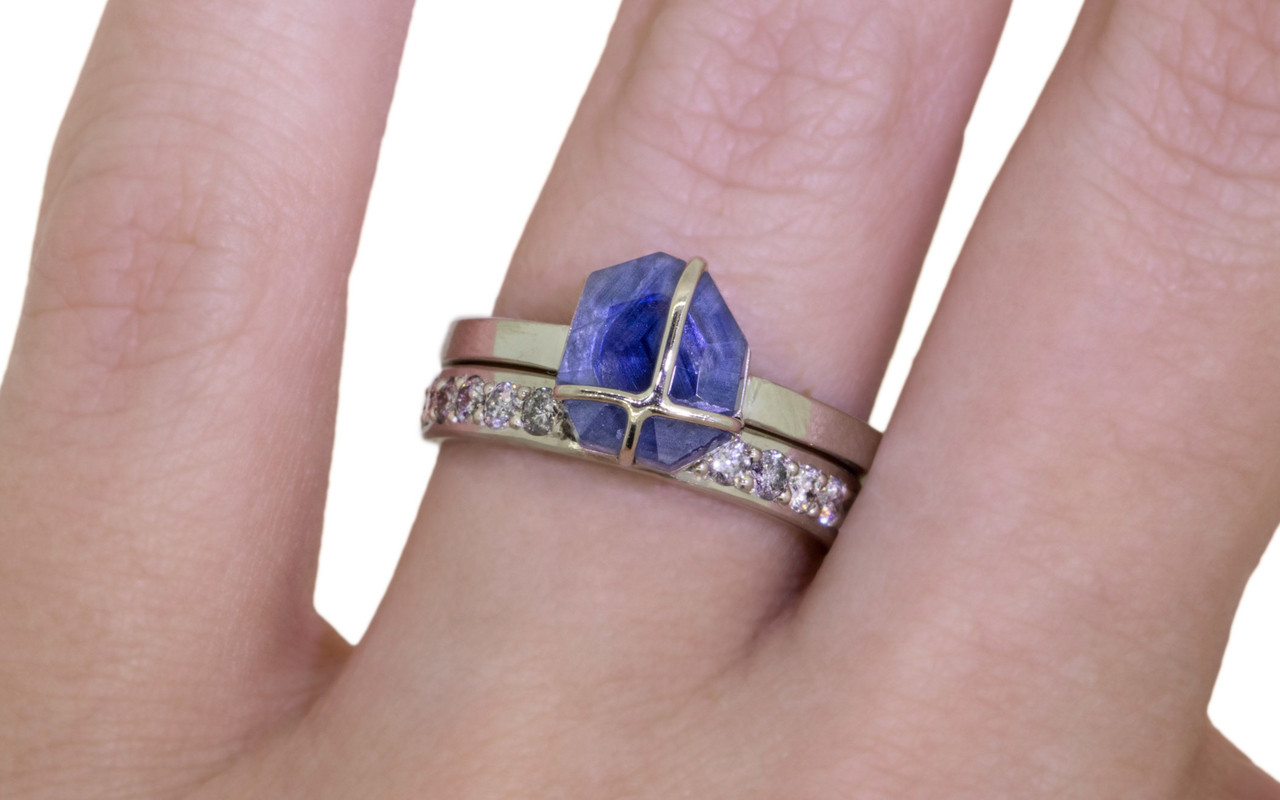 1.66 carat hand-cut blue sapphire 2mm flat band 14k white gold with Wedding Band with 16 Gray Diamonds on a hand
