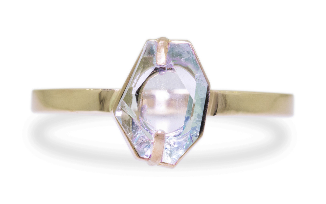 1.37 carat hand-cut aquamarine 2mm flat band front view on white background.  The ring is 14k yellow gold.
