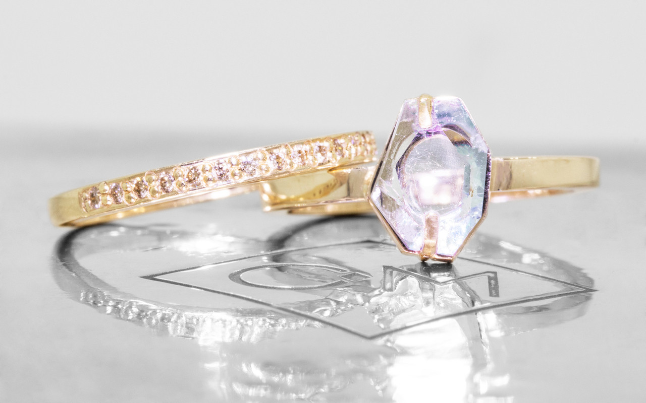 1.37 carat hand-cut aquamarine 2mm flat band with Wedding Band with 16 Gray Diamonds.  The ring is 14k yellow gold.