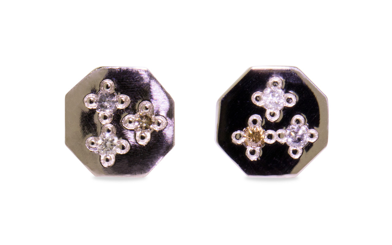 Askja 14k white gold hexagon stud earrings with white, gray and champagne pave diamonds set in surface.