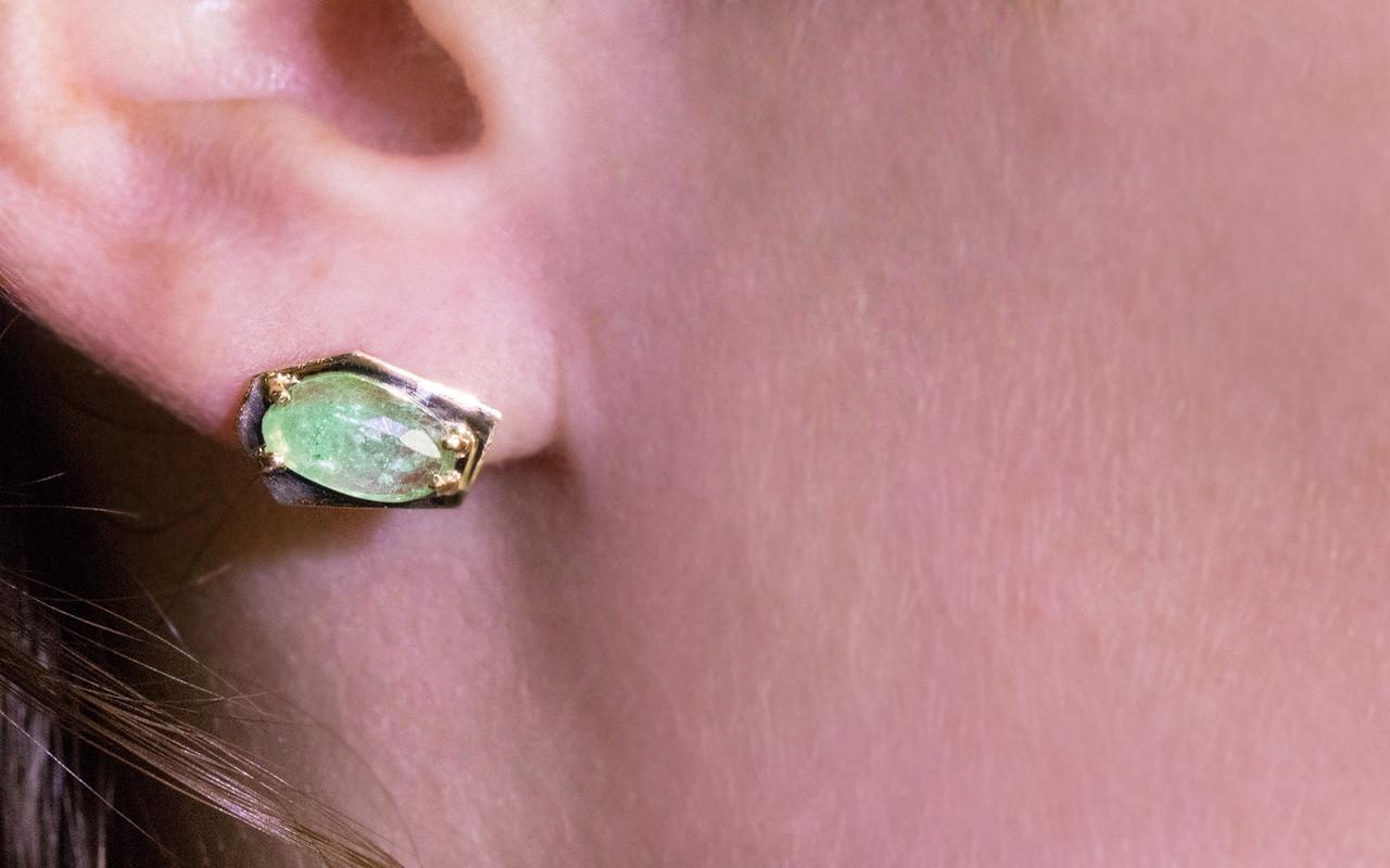New classic KIKAI stud earrings 1.59 carat free-form, rose-cut, emerald prong set in open back geometric 14k yellow gold setting shown on ear