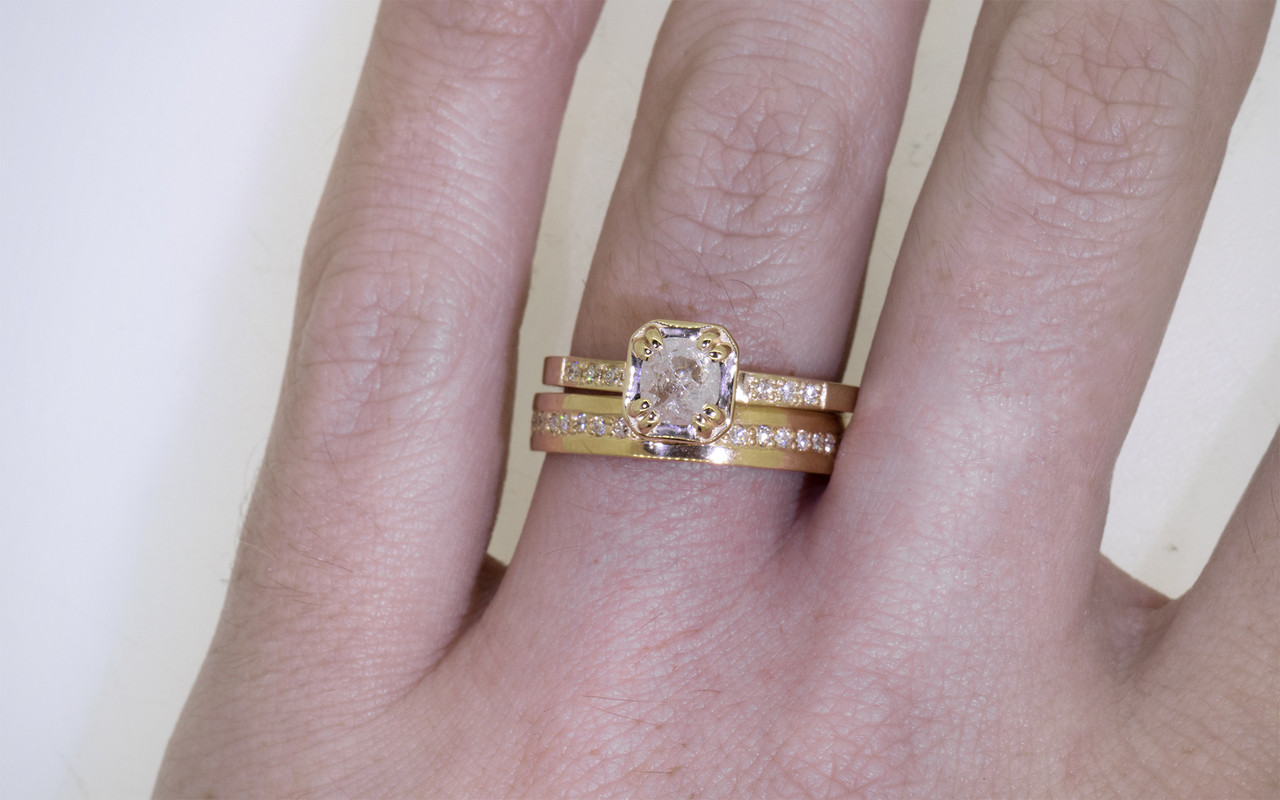 AIRA .44 carat  hexagon rose cut icy white diamond prong set in 14k yellow gold geometric octangular setting. 1.2mm brilliant white diamonds set in 14k yellow gold band. New Classic Collection. Modeled on hand with 14k yellow gold eternity wedding band