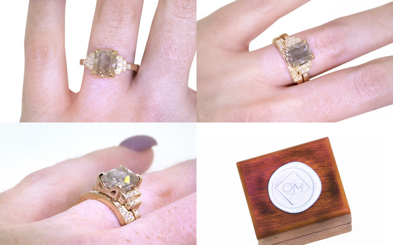 3.03 carat Champagne Diamond, emerald, rectangle cut engagement ring with shadow wedding band stacked with it.  Set is made in 14k recycled yellow gold.  White diamonds on the shoulders and in the weddings band.  Geometric design with art deco style.  Modeled on a hand with wooden ring box with Chinchar/Maloney wax seal stamped on it.