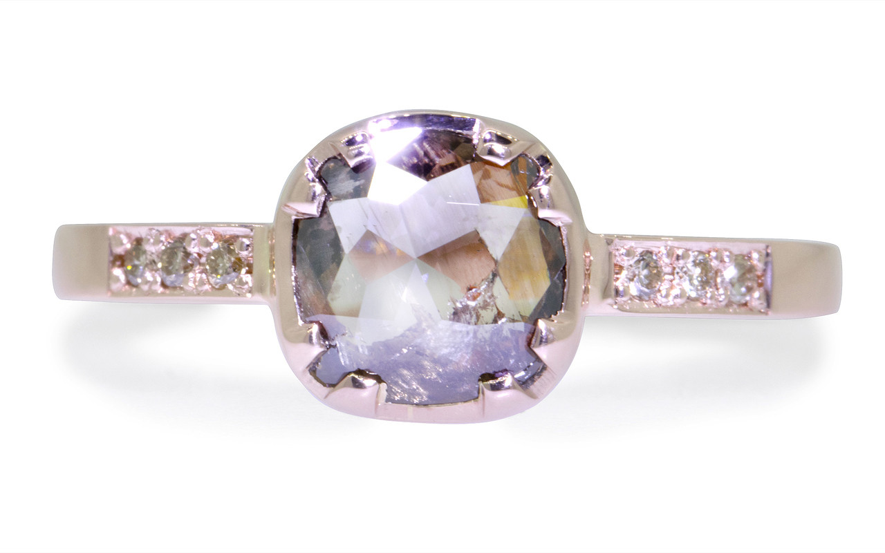 .84 carat cushion, rose cut translucent, smoky champagne prong/bezel set diamond ring with six 1.2mm brilliant champagne diamonds set into band set in 14k rose gold flat band. Front view on white background
