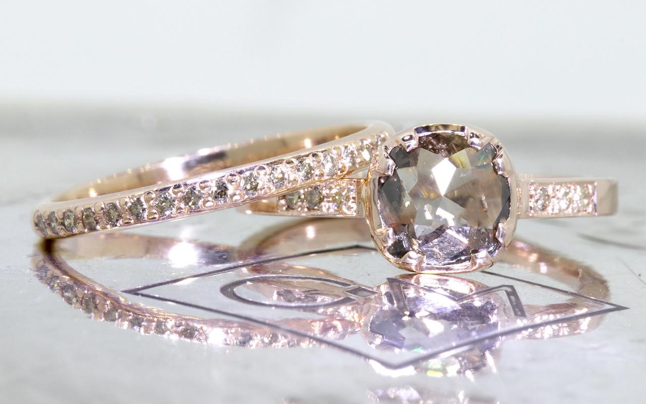 .84 carat cushion, rose cut translucent, smoky champagne prong/bezel set diamond ring with six 1.2mm brilliant champagne diamonds set into band set in 14k rose gold flat band. With Wedding band with 16 brilliant champagne diamonds set into 14k rose gold