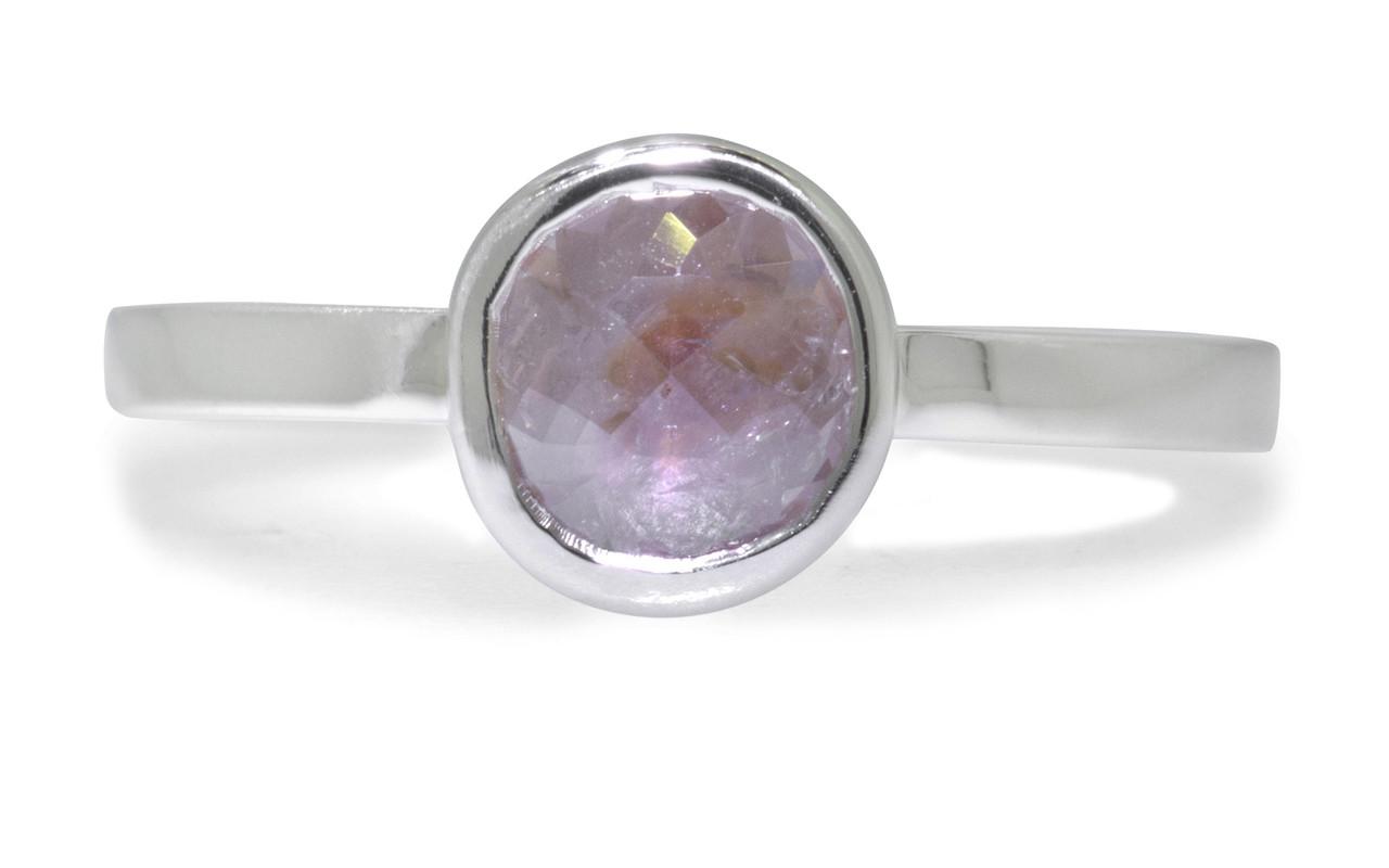 .61 carat  rose cut rosey pink bezel set diamond ring set in 14k white gold flat band. Front view on white background