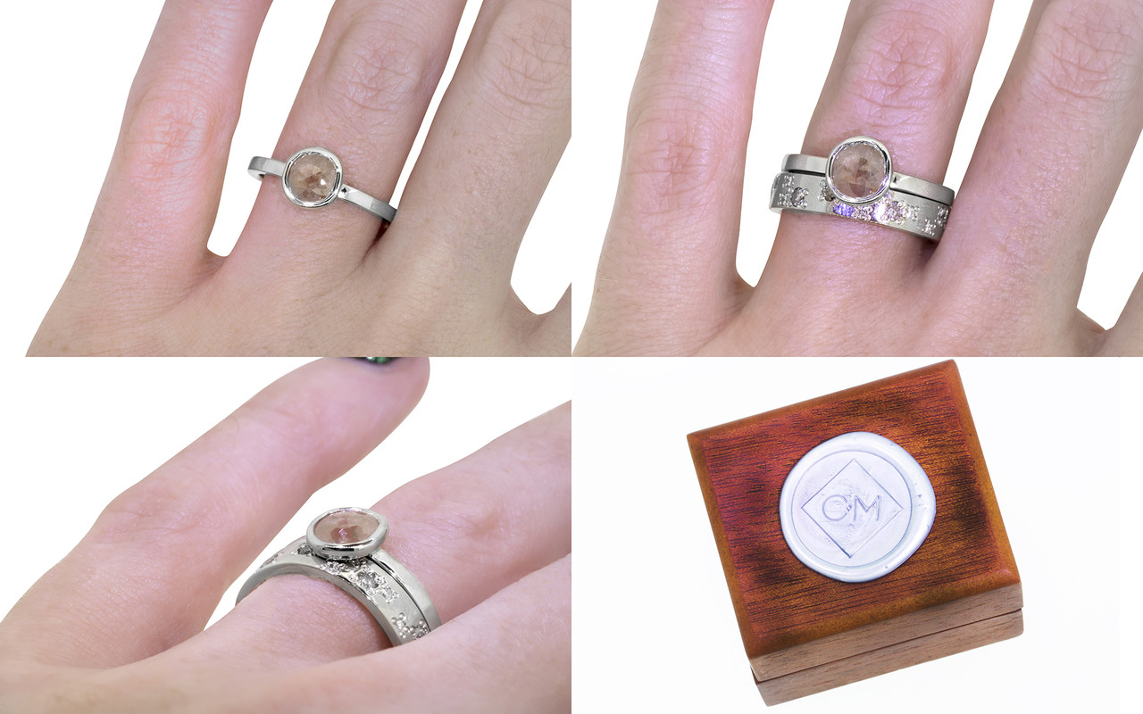 .61 carat  rose cut rosey pink bezel set diamond ring set in 14k white gold flat band. With Organic Wedding Band with brilliant gray and white diamonds set in 14k white gold 4mm flat band on a hand with wooden box stamped with wax seal Chinchar/Maloney logo