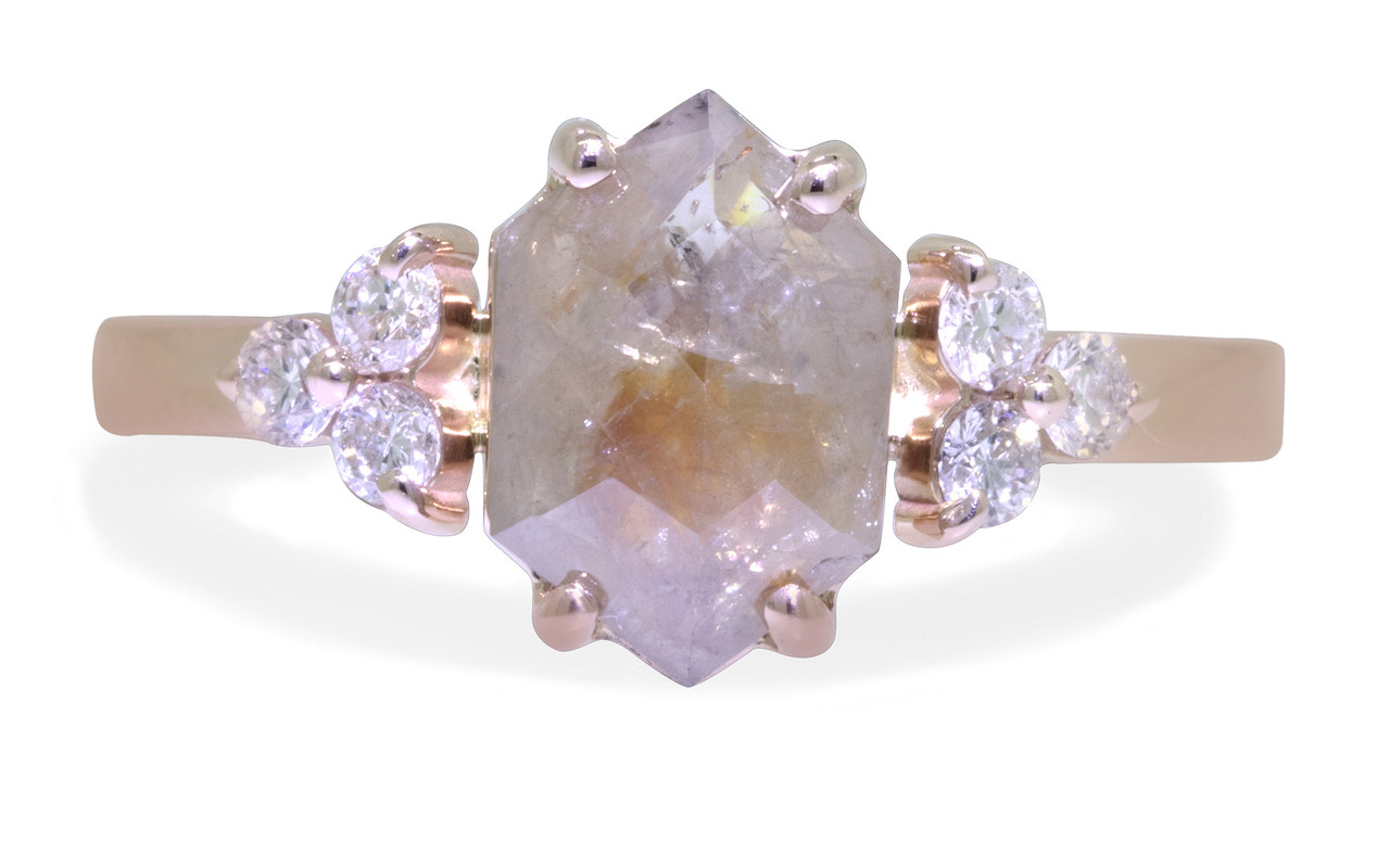 1.42 carat hexagonal, rose-cut gray and peach prong set diamond ring set in 14k rose gold with six 2mm brilliant white diamond clusters on either side of main setting flat band. Front view on white background