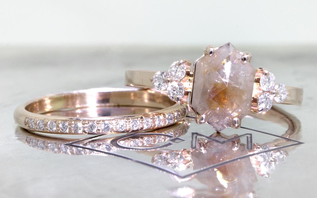 1.42 carat hexagonal, rose-cut gray and peach prong set diamond ring set in 14k rose gold with six 2mm brilliant white diamond clusters on either side of main setting flat band. Wedding Band with 16 brilliant white diamonds in 14k rose gold 1/2 round band