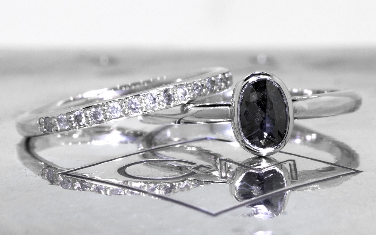 .57 carat  oval, rose cut natural black bezel set diamond ring set in 14k white gold 1/2 round band. With Wedding Band with 16 brilliant gray diamonds set in 14k white gold 1/2 round band