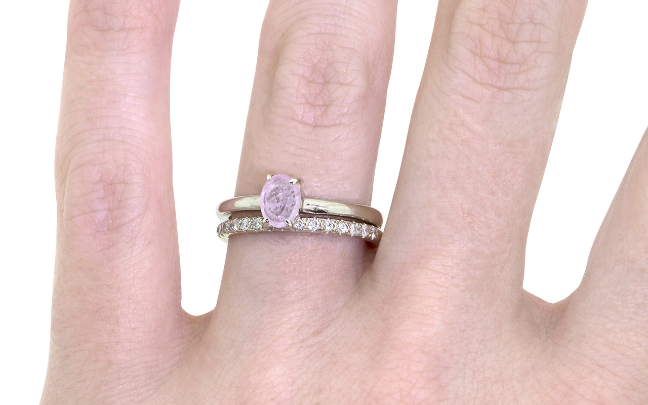 .73 carat pink rose cut sapphire set in 14k white gold 1/2 round band. With Wedding Band with 16 brilliant white diamonds in 14k white gold on a hand