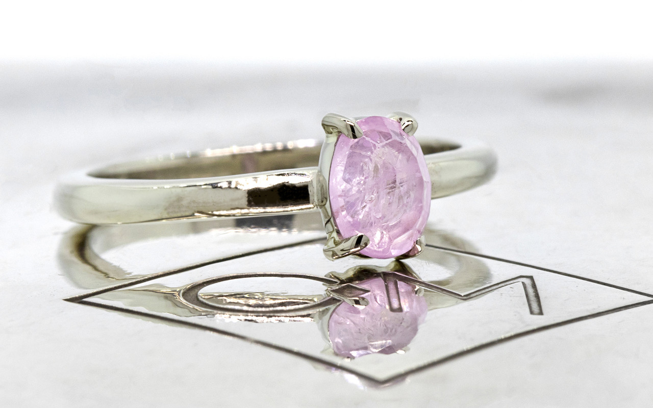 .73 carat pink rose cut sapphire set in 14k white gold 1/2 round band. 3/4 view on metal background with Chinchar/Maloney logo