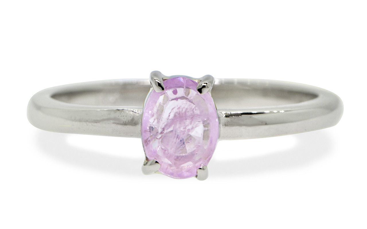 .73 carat pink rose cut sapphire set in 14k white gold 1/2 round band. Front view on white background